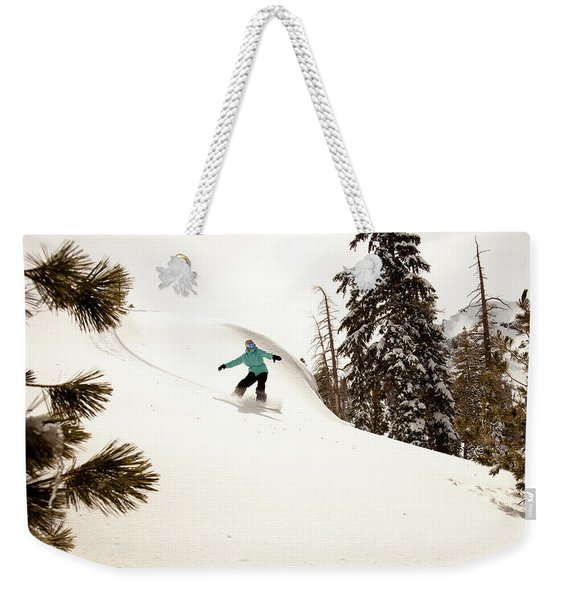 A Female Snowboarder Lays Out Some Weekender Tote Bag
