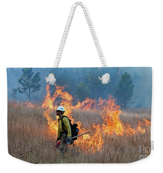 A Firefighter Ignites The Norbeck Prescribed Fire. Weekender Tote Bag