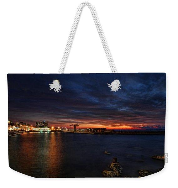 a flaming sunset at Tel Aviv port Weekender Tote Bag