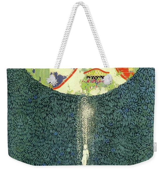 A Fountain With A Hedge In The Background Weekender Tote Bag