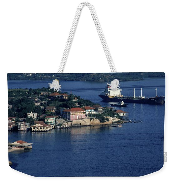 A Freighter Moves Along The Coast Weekender Tote Bag