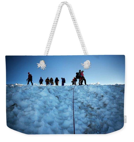A Group Of Mountaineers Pause Weekender Tote Bag