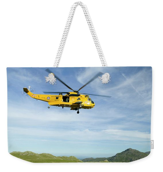 A Helicopter Comes To Evacuate An Weekender Tote Bag