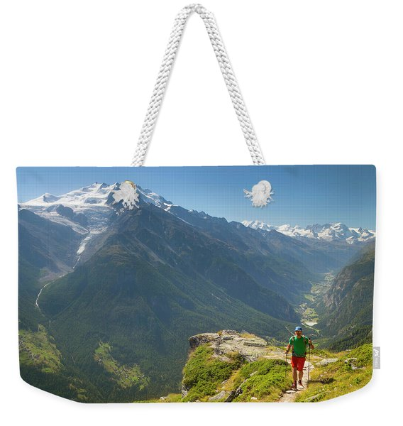 A Hiker Is Walking Over A Mountain Weekender Tote Bag