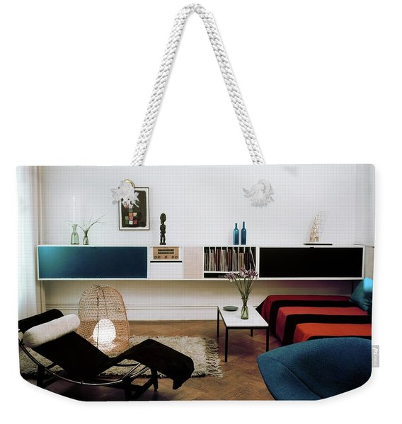 A Living Room With A Le Corbusier Chair Weekender Tote Bag
