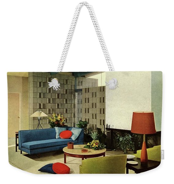 A Living Room With Carpeting By Callaway Weekender Tote Bag