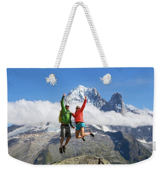 A Male And Female In Colorful Clothing Weekender Tote Bag