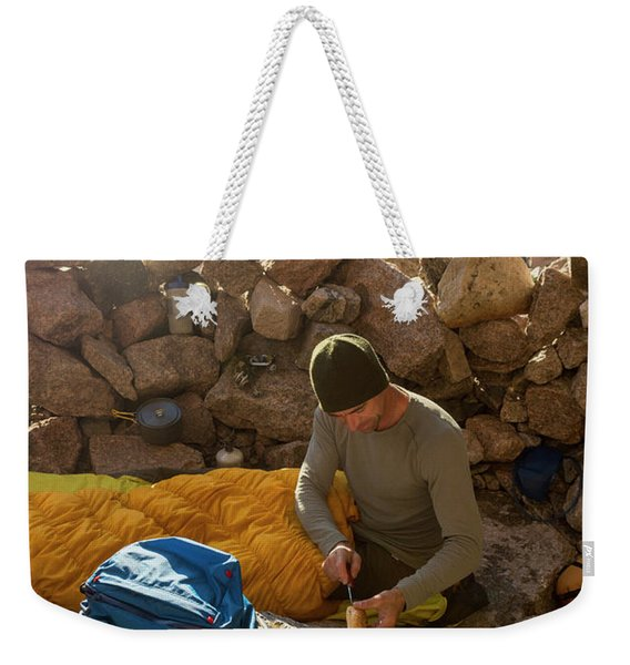 A Male Mountain Climber Getting Ready Weekender Tote Bag