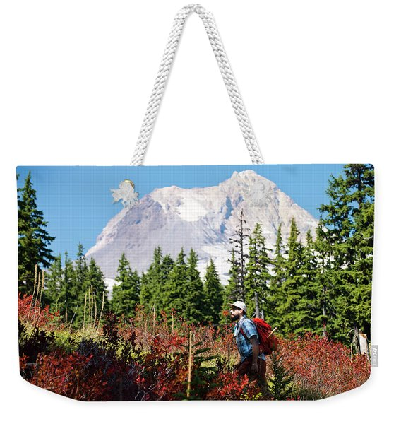 A Man Hikes Through The Mountains Weekender Tote Bag