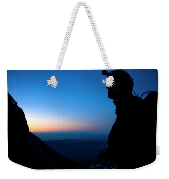 A Man Looks Up At The Summit Of Mount Weekender Tote Bag