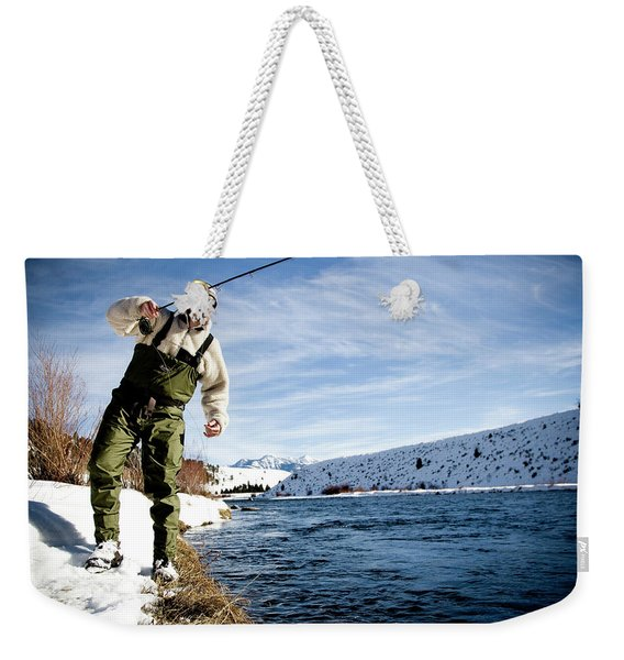 A Man Out Fly Fishing On A Winter Day Weekender Tote Bag