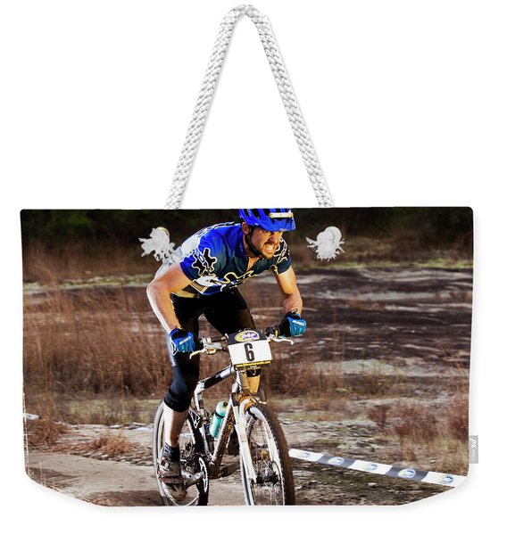 A Man Rides Aggressively Up A Muddy Weekender Tote Bag