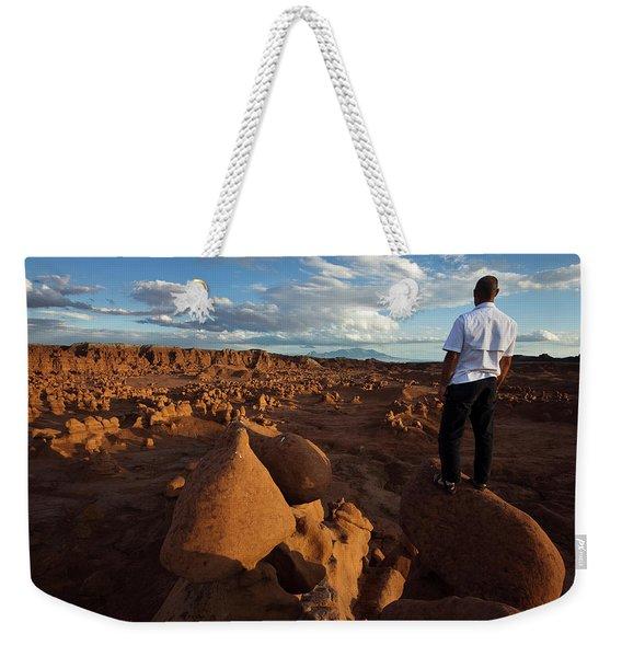 A Man Standing On Rocks Overlooking Weekender Tote Bag