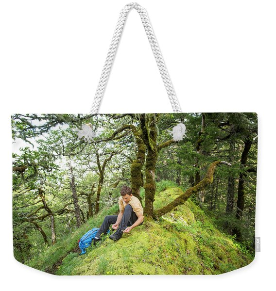 A Man Ties His Boots On A Mossy Trail Weekender Tote Bag