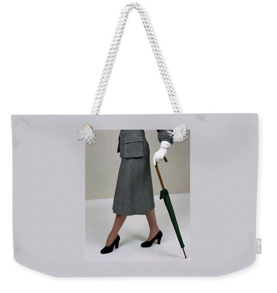 A Model Holding An Umbrella Weekender Tote Bag
