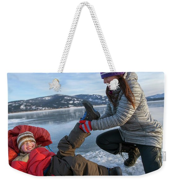 A Mom Helping A Little Boy Get Ready Weekender Tote Bag
