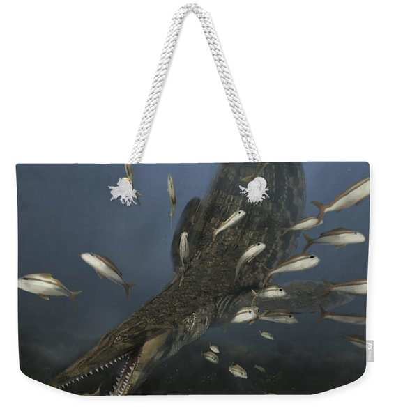 A Mosasaurus Feeds On A Small School Weekender Tote Bag