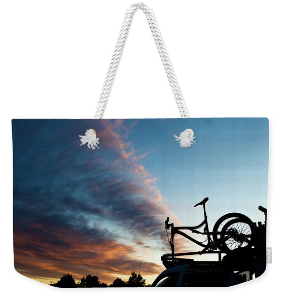A Mountain Bike On The Roof Of A Truck Weekender Tote Bag