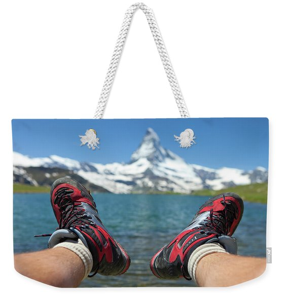 A Mountain Hiker Is Resting At A Lake Weekender Tote Bag