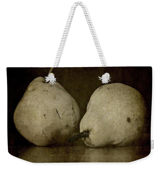 Weekender Tote Bag featuring the photograph A Pair Of Pears by Patricia Strand
