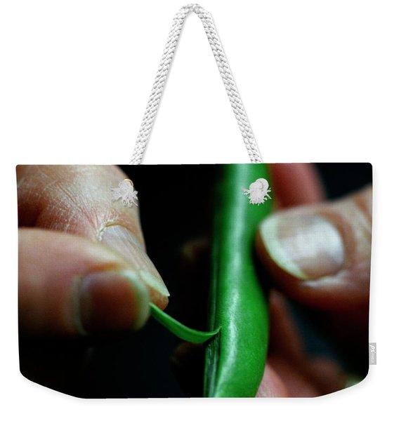 A Person Peeling A Bean Weekender Tote Bag