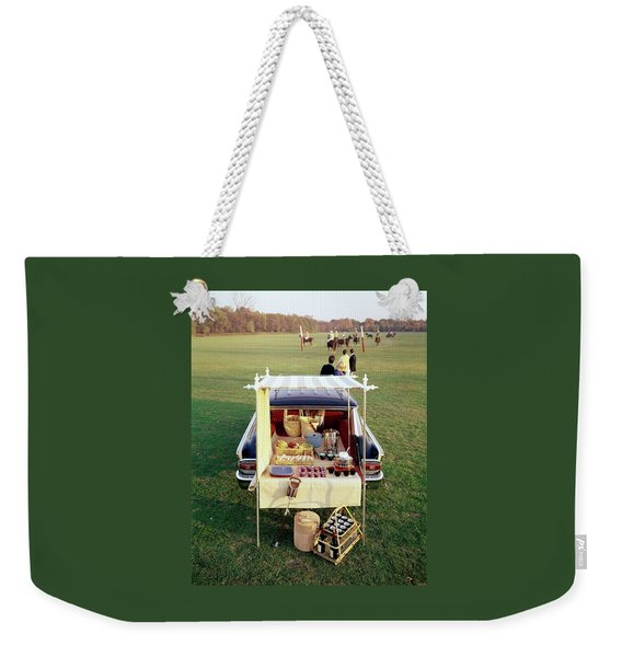 A Picnic Table Set Up On The Back Of A Car Weekender Tote Bag
