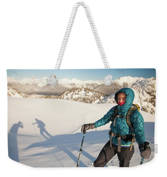A Portrait Of A Woman Snowshoeing Weekender Tote Bag