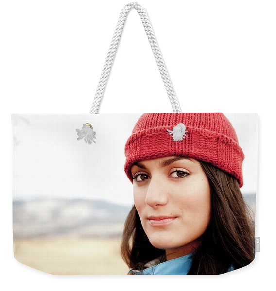 A Portrait Of A Young Woman While Weekender Tote Bag
