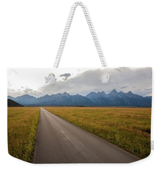 A Road Leading Toward The Grand Teton Weekender Tote Bag