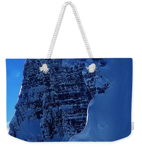 A Skier Drops From Snowy Cliff Weekender Tote Bag