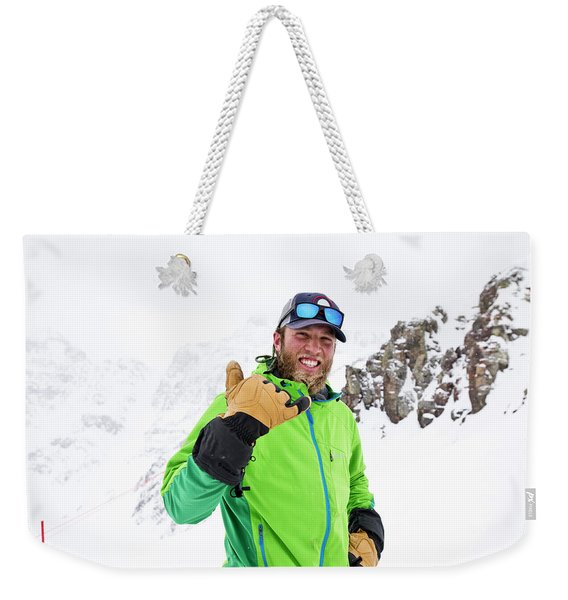 A Skier Smiles During A Sunny Day Weekender Tote Bag