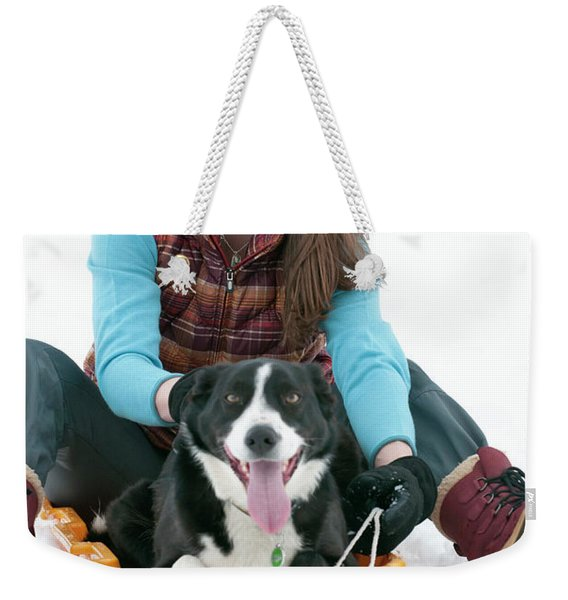 A Smiling Young Woman Rides A Sled Weekender Tote Bag
