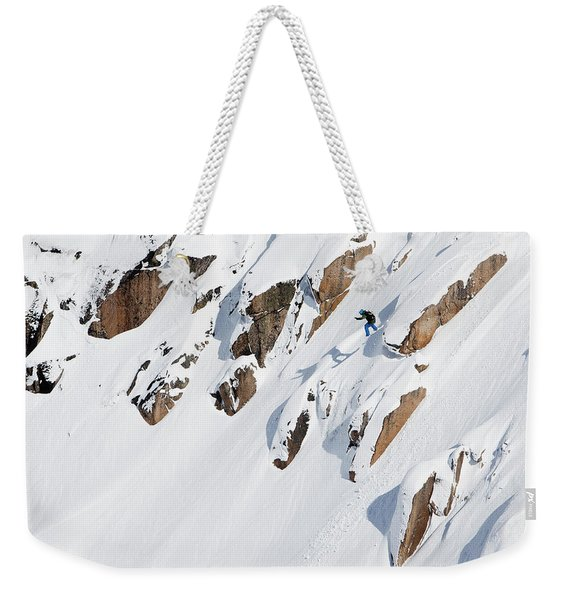 A Snowboarder Jumping Off A Cliff Weekender Tote Bag