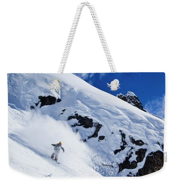 A Snowboarder Slashes Powder Snow Weekender Tote Bag