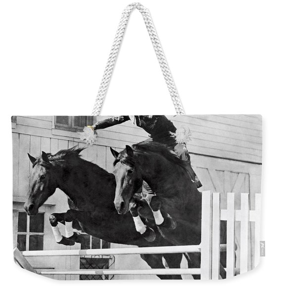 A Stunt Rider On Two Horses. Weekender Tote Bag