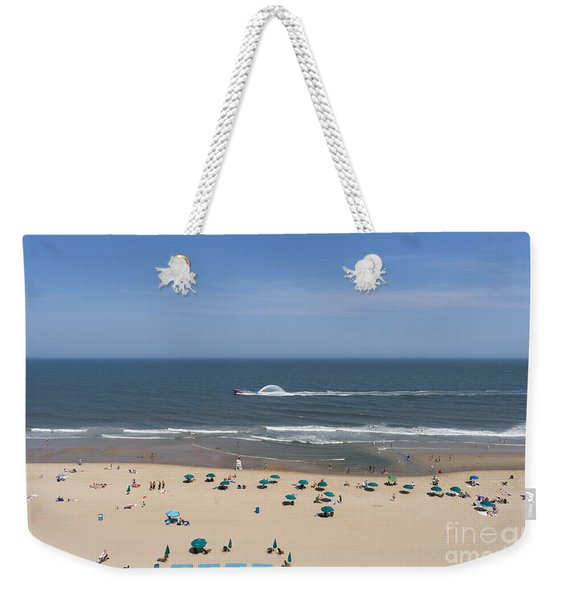 A Touring Speedboat Passes By Shore In Ocean City Maryland Weekender Tote Bag