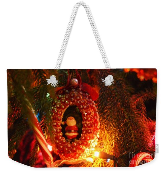 Weekender Tote Bag featuring the photograph A Treasured Santa by Laurie Lundquist