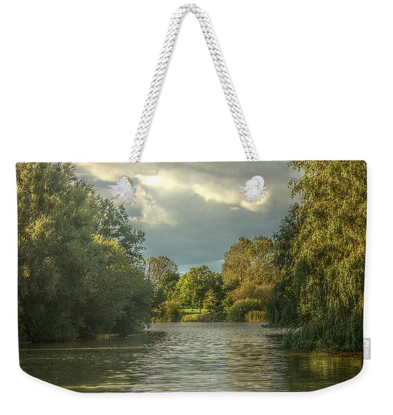 Weekender Tote Bag featuring the photograph A View Down The Lake by Jeremy Hayden