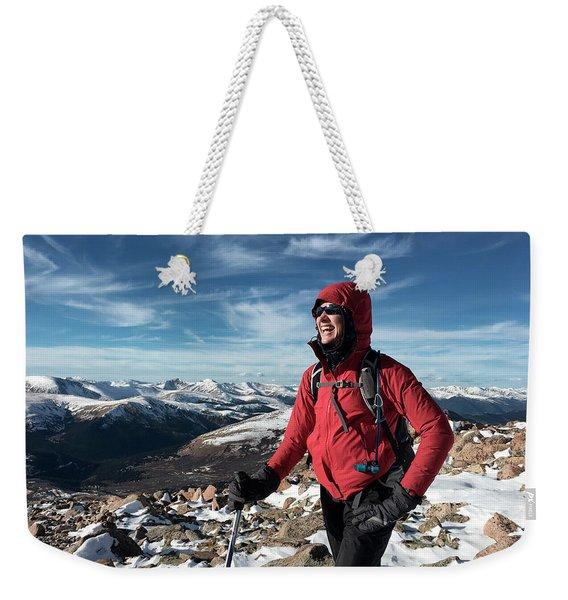 A Woman Summits Mt. Bierstadt In Winter Weekender Tote Bag