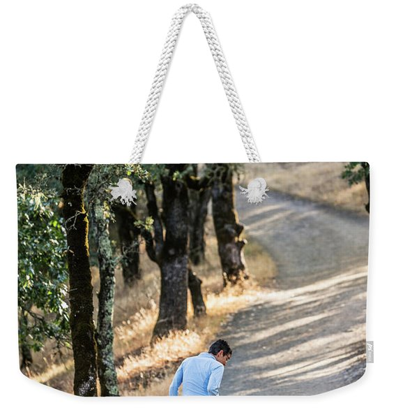 A Woman Takes Her Dog For A Walk Weekender Tote Bag