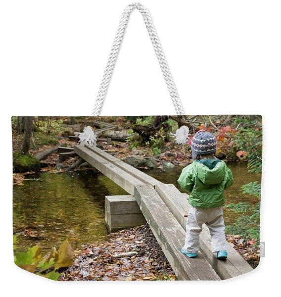 A Young Girl Walks Across Hiking Weekender Tote Bag