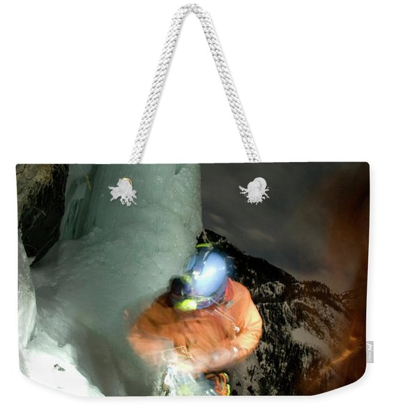 A Young Man Prepares For Ice Climbing Weekender Tote Bag