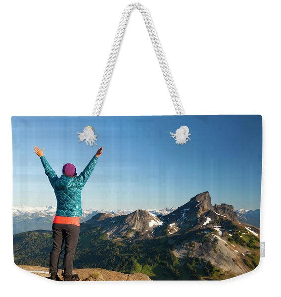 A Young Woman Celebrates After Reaching Weekender Tote Bag