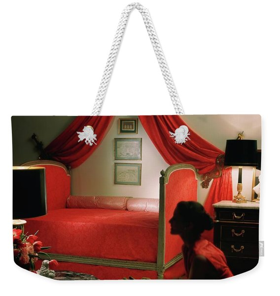 A Young Woman Sitting In A Red Bedroom Weekender Tote Bag
