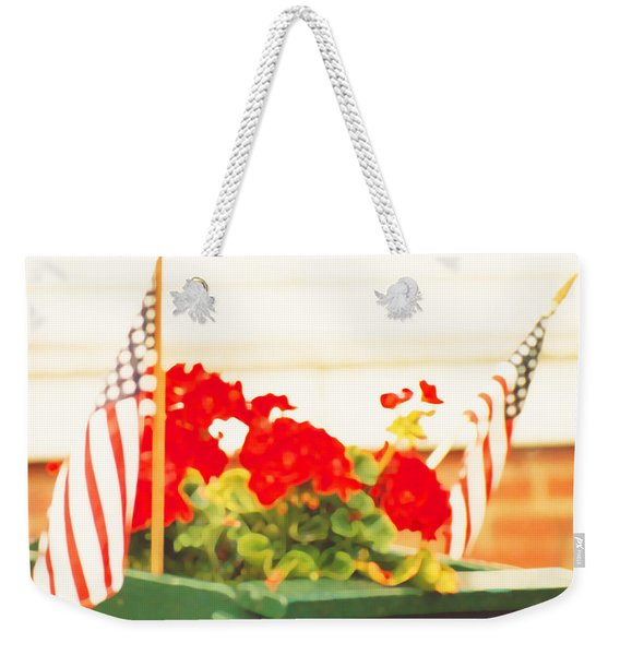 Weekender Tote Bag featuring the photograph American Flags And Geraniums In A Wheelbarrow In Maine, One by Marian Cates