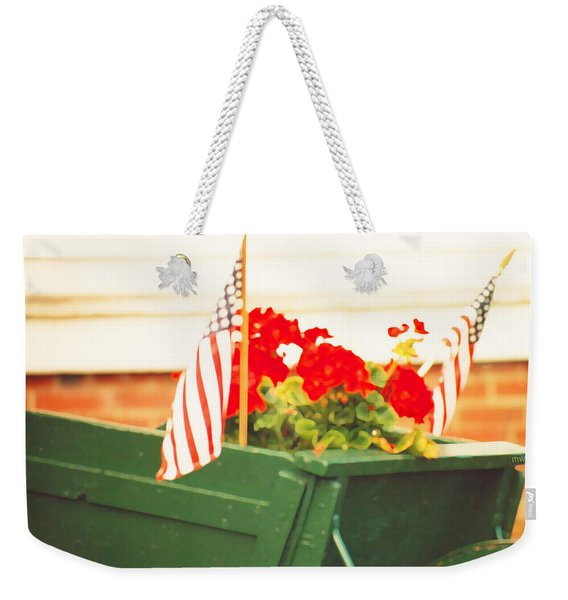 Weekender Tote Bag featuring the photograph American Flags And Geraniums In A Wheelbarrow In Maine, Two by Marian Cates