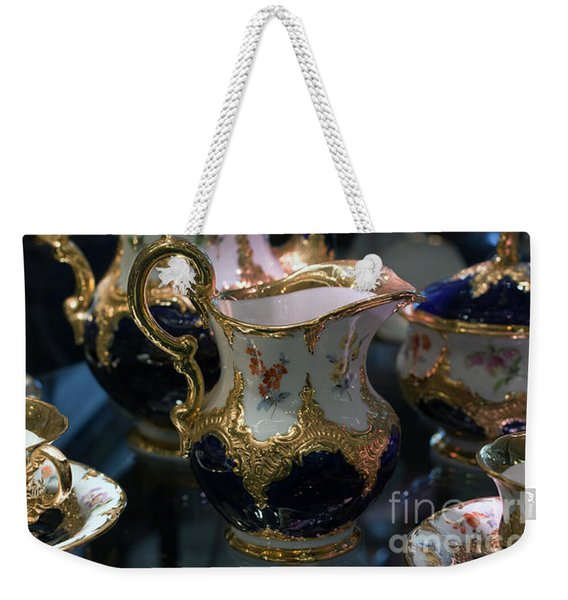 Weekender Tote Bag featuring the photograph Antique Porcelain Coffee Set In Show Case by Gunter Nezhoda