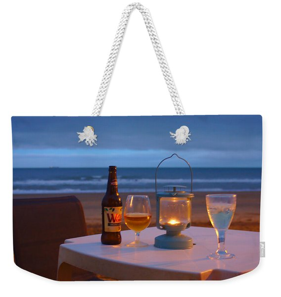 Weekender Tote Bag featuring the photograph At The End Of The Day by Jeremy Hayden