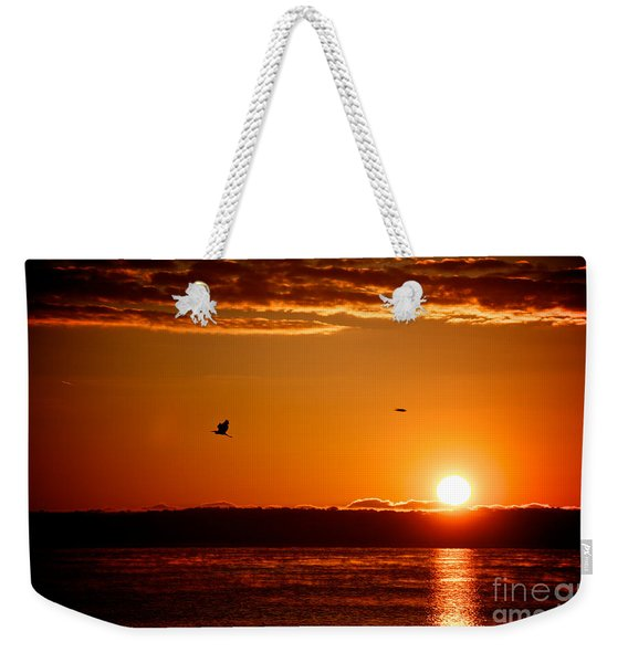 Weekender Tote Bag featuring the photograph Awakening Sun by William Norton