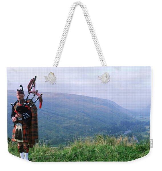 Bagpiper At Loch Broom In Scottish Weekender Tote Bag